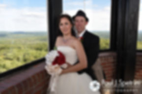 Amanda and Chris smile for a photo following their summer wedding at the Quabbin Reservoir Observation Tower in Belchertown, Massachusetts on July 2nd, 2016.