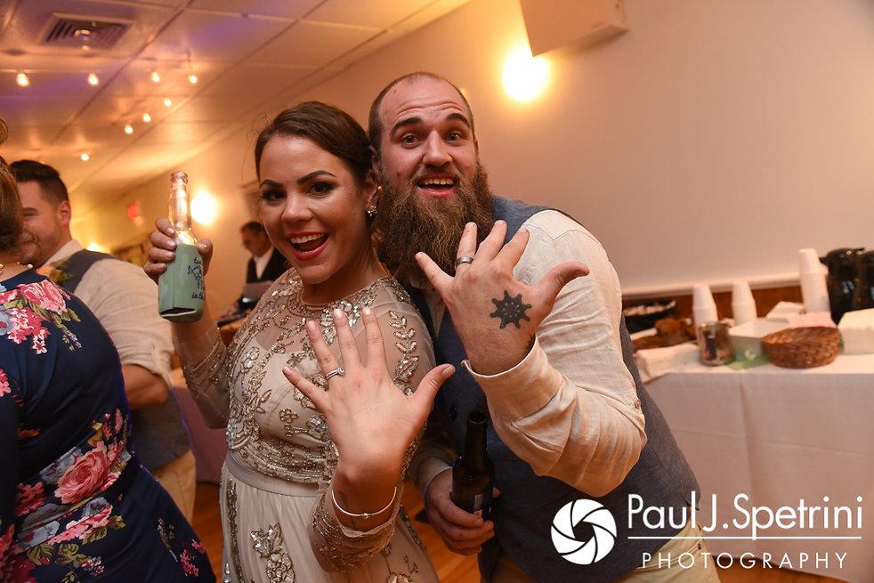 Arielle and Gary show off their rings during their September 2017 wedding reception at North Beach Club House in Narragansett, Rhode Island.