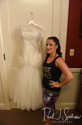 Courtnie poses for a photo near her wedding dress prior to her August 2018 wedding ceremony at Glad Tidings Church in Quincy, Massachusetts.
