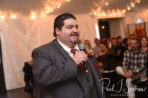 The best man gives a toast during Rich & Makayla's October 2018 wedding wedding reception at Zukas Hilltop Barn in Spencer, Massachusetts.