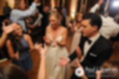 Laura and Laki dance with guests during their September 2017 wedding reception at Lake of Isles Golf Club in North Stonington, Connecticut.