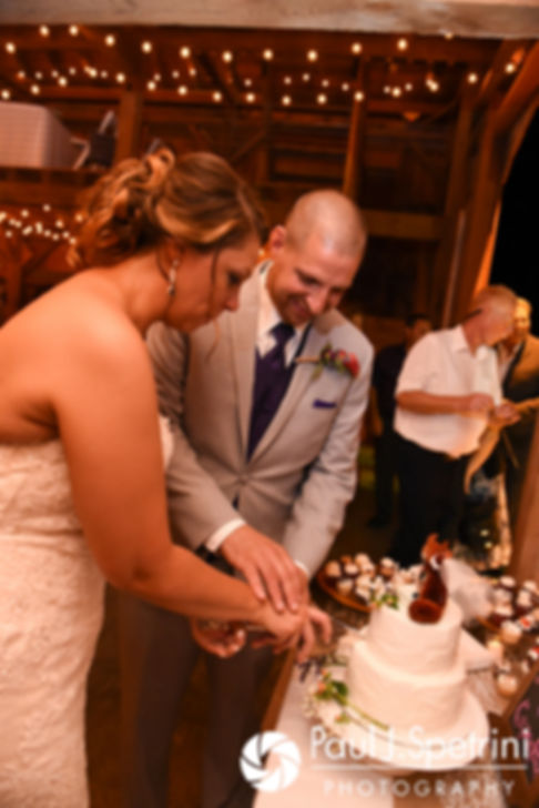 Kevin and Jennifer cut their wedding cake during their September 2017 wedding reception at Allen Hill Farm in Brooklyn, Connecticut.