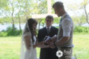 Krystal and Ian exchange their vows during their May 2016 wedding at Colt State Park in Bristol, Rhode Island.