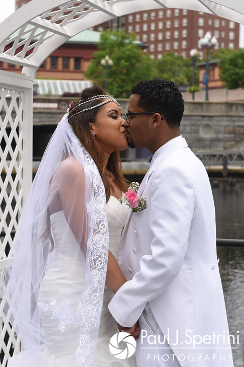 Lucelene and Luis share a kiss during their June 2017 wedding ceremony at Waterplace Park in Providence, Rhode Island.