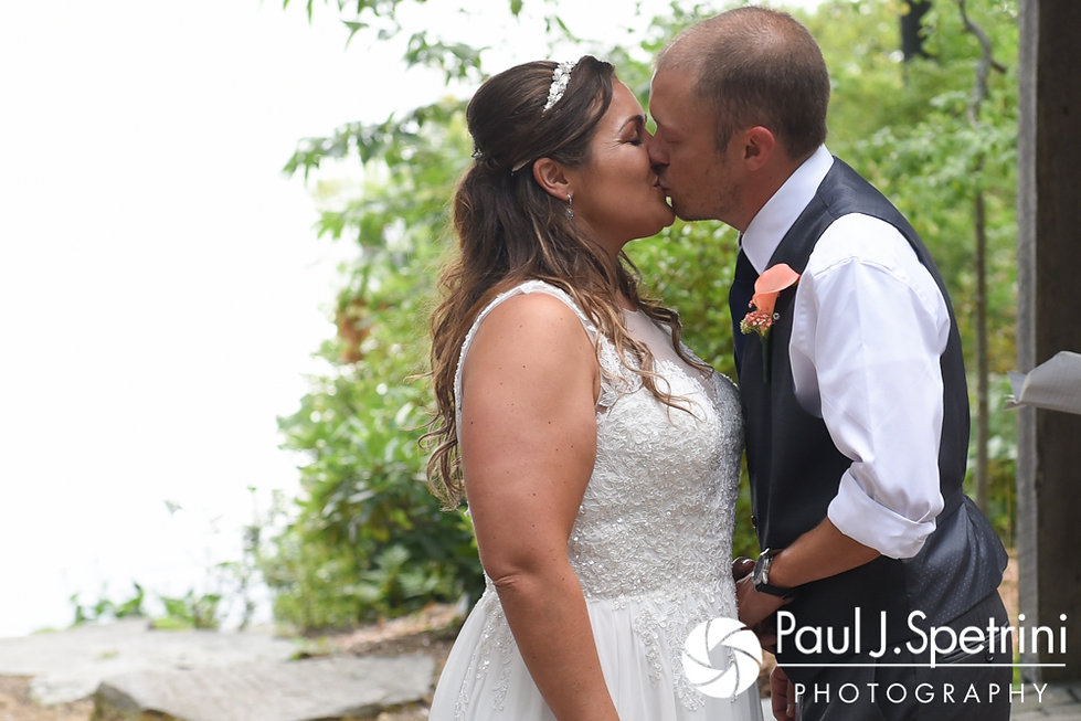Toni and Scott share their first kiss as husband and wife during their August 2017 wedding ceremony at Crystal Lake Golf Club in Mapleville, Rhode Island.