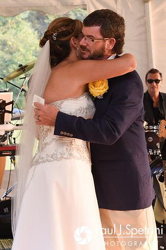 One of Kelly's best men hugs Rebecca following a speech during Rebecca and Kelly's August 2017 wedding reception in Warwick, Rhode Island.
