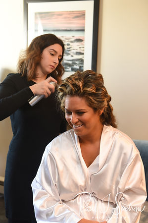 Cara gets her hair done during her bridal prep session at the Aqua Blue Hotel in Narragansett, Rhode Island prior to her November 2018 wedding.