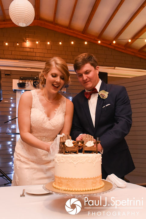 Mike and Rachel cut the cake during their October 2017 wedding reception at Castle Manor Inn in Gloucester, Massachusetts.