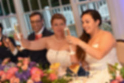 Laura and Marijke raise their glasses for a toast during their June 2018 wedding reception at Independence Harbor in Assonet, Massachusetts.