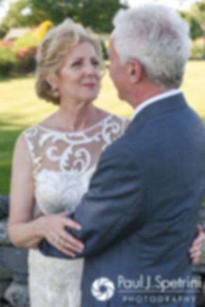 Debbie smiles for a photo following her June 2016 wedding in Barrington, Rhode Island.