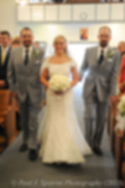 The ring bearer walks down the aisle during Justin and Jamie Bolani's wedding ceremony at Prescott Farms in Portsmouth, Rhode Island in June 2015.