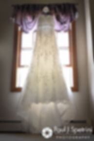 Lauryn's dress hangs up prior to her July 2016 wedding at St. Paul the Apostle Catholic Church in Foster, Rhode Island.