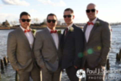 David poses for a photo with his groomsmen prior to his December 2016 wedding ceremony at the Waterman Grille in Providence, Rhode Island.