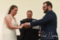 Rob and Allie exchange rings during their October 2018 wedding ceremony at South Ferry Church in Narragansett, Rhode Island.