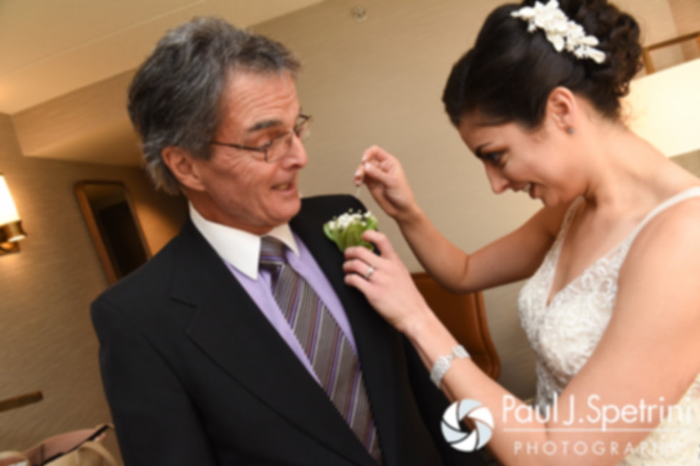 Gina pins a flower on her father prior to her December 2016 wedding ceremony at the Waterman Grille in Providence, Rhode Island.