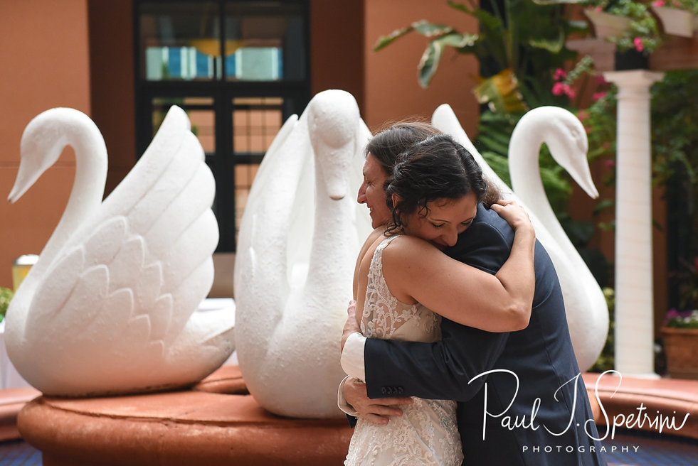 Amanda and Josh hug during their October 2018 wedding ceremony at the Walt Disney World Swan & Dolphin Resort in Lake Buena Vista, Florida.