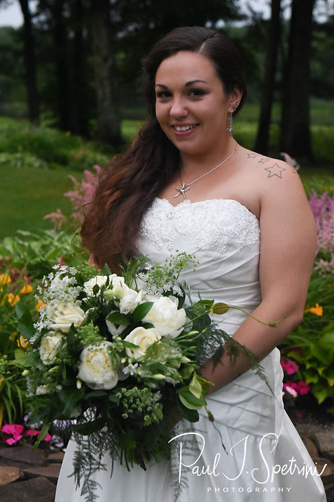 Laura poses for a bridal portrait following her June 2018 wedding ceremony at Independence Harbor in Assonet, Massachusetts.
