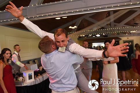 John jumps into a guest's hands during his July 2016 wedding reception at Crystal Lake Golf Club in Burrillville, Rhode Island.