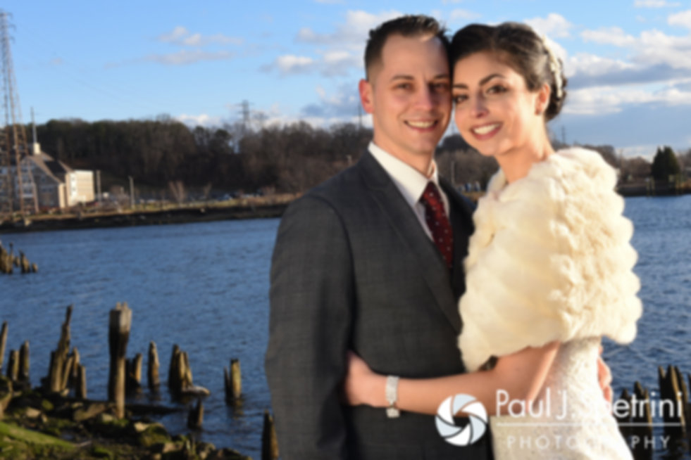 Gina and David smile for a formal photo prior to their December 2016 wedding ceremony at the Waterman Grille in Providence, Rhode Island.