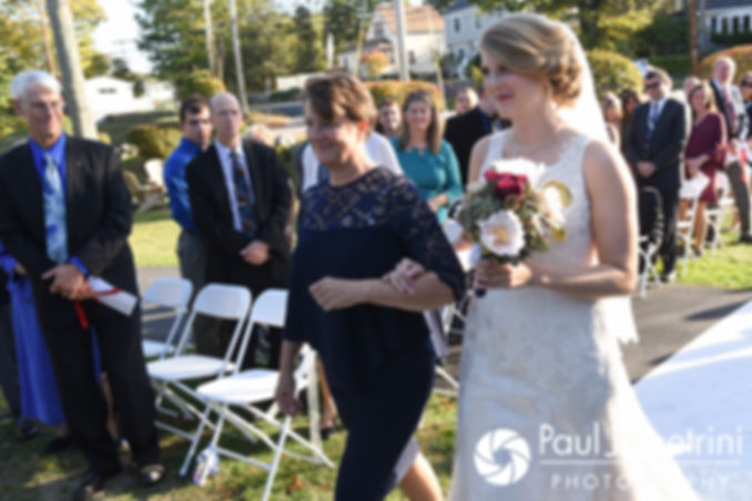 Rachel walks down the aisle during her October 2017 wedding ceremony at Castle Manor Inn in Gloucester, Massachusetts.