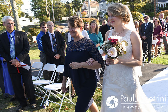 Rachel walks down the aisle during her October 2017 wedding ceremony at Castle Manor Inn in Gloucester, Massachusetts.