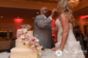 Michelle and Eric cut their wedding cake during their May 2016 wedding at Hillside Country Club in Rehoboth, Massachusetts.