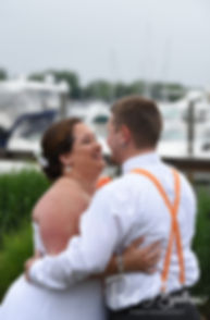 Samantha & Kyle kiss during their June 2018 wedding ceremony at Chelo's Waterfront Bar & Grille in Warwick, Rhode Island.