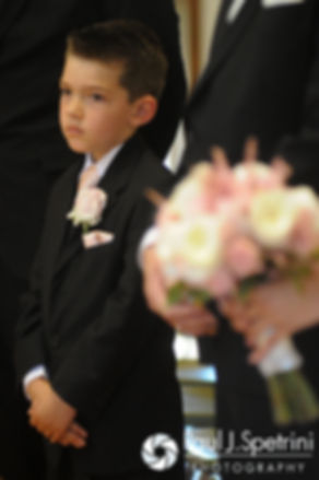 Justin and Lauryn's son looks on during his parents' July 2016 wedding at St. Paul the Apostle Catholic Church in Foster, Rhode Island.