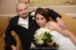 Jennifer and Adam smile for a photo during their December 2012 wedding.