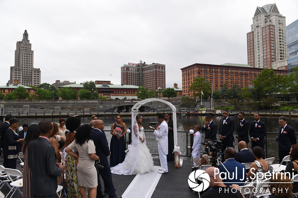 Lucelene and Luis exchange vows during their June 2017 wedding ceremony at Waterplace Park in Providence, Rhode Island.