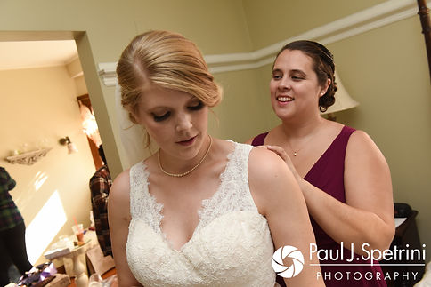 Rachel's dress is zipped up prior to her October 2017 wedding ceremony at Castle Manor Inn in Gloucester, Massachusetts.