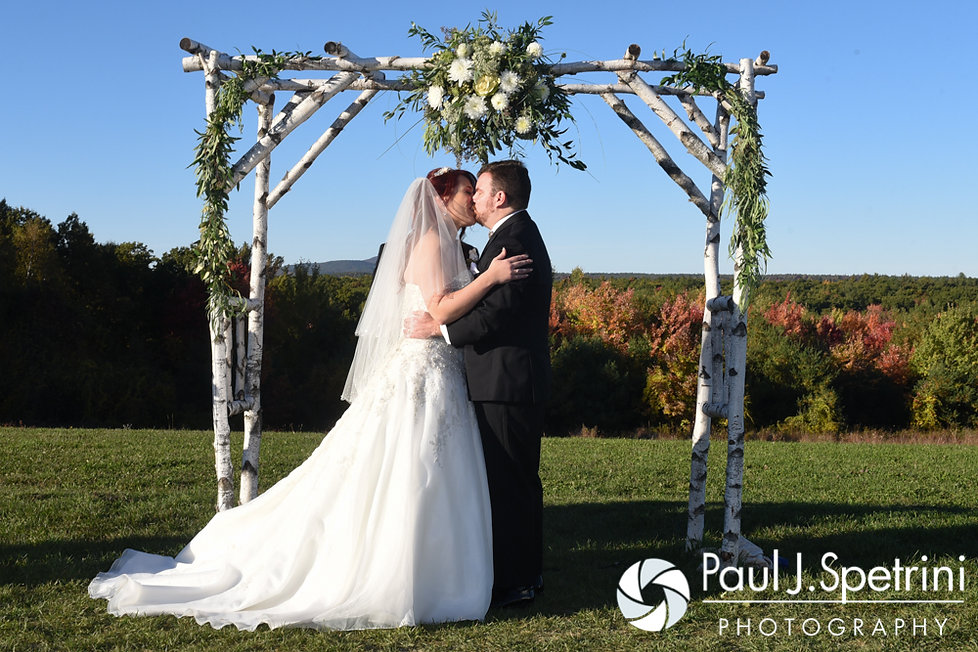JD and Brooke kiss during their October 2016 wedding ceremony at The Farm at SummitWynds in Jefferson, Massachusetts.