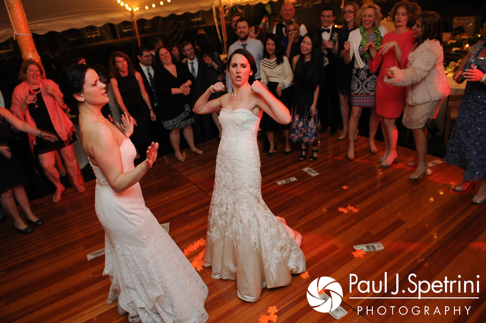 Caroline and Morgan dance during their April wedding reception at the Fort Adams Trust in Newport, Rhode Island.