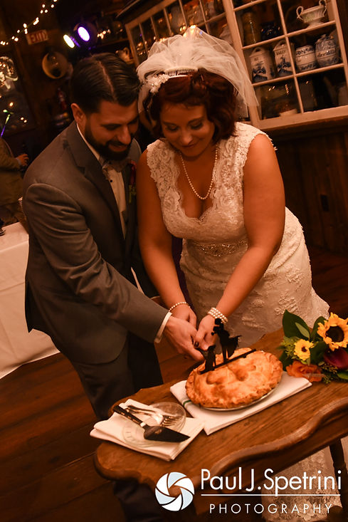 Crystal and Andy cut their 'wedding pie' during their November 2016 wedding reception at the Salem Cross Inn in West Brookfield, Massachusetts.