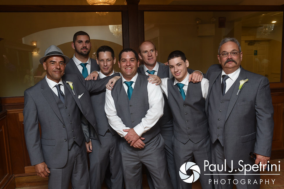 Paul poses for a photo with his groomsmen during his September 2016 wedding reception at the Aqua Blue Hotel in Narragansett, Rhode Island.