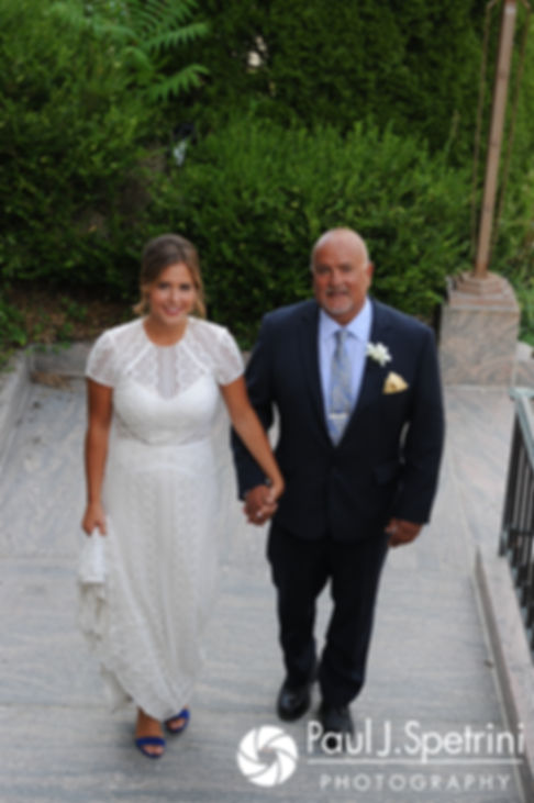 Jennifer and her father walk into the church prior to her August 2017 wedding ceremony at St. Joseph Church in New London, Connecticut.