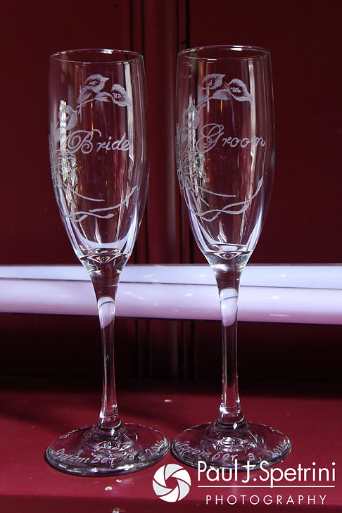 A look at bride and groom champagne glasses on display at Jen's home prior to her and Kyle's September 2016 wedding at the Roger Williams Park Botanical Center in Providence, Rhode Island.