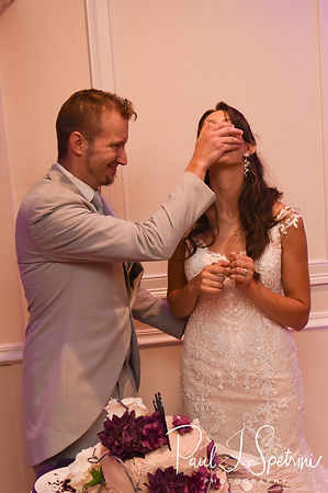 Beth & Bryan cut their wedding cake during their August 2018 wedding reception at McGovern's on the Water in Fall River, Massachusetts.