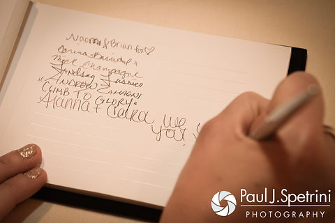 A guest signs Michelle and Eric's guestbook during their May 2016 wedding at Hillside Country Club in Rehoboth, Massachusetts.