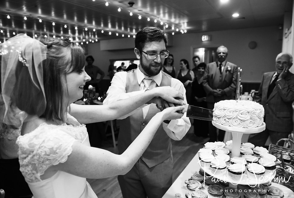 Amber & Justin cut their wedding cake during their June 2018 wedding reception at North Beach Clubhouse in Narragansett, Rhode Island.