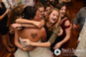 Kelly's dance students give her a hug during her November 2016 wedding reception at the Bay Pointe Club in Buzzards Bay, Massachusetts.