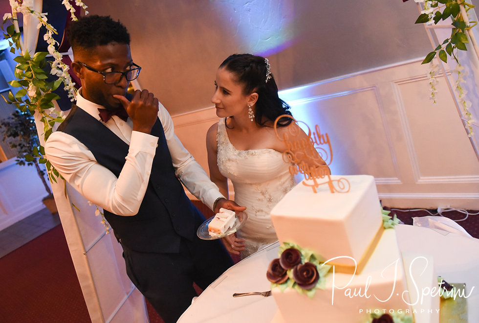 Courtnie and Richardson cut their wedding cake during their August 2018 wedding reception at Emerald Hall in Abington, Massachusetts.