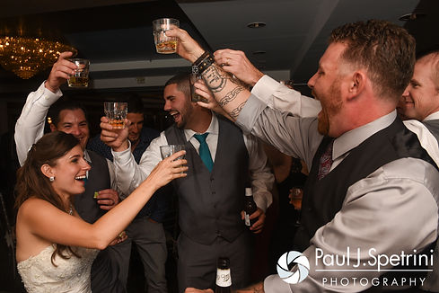Guests drink during Marissa and Paul's September 2016 wedding reception at the Aqua Blue Hotel in Narragansett, Rhode Island.