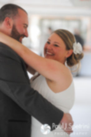 Latasha and Justin's share their first dance during their May 2016 wedding reception at Country Gardens in Rehoboth, Massachusetts.