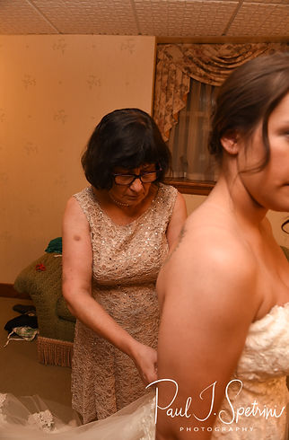 Danielle has her dress zipped up prior to her August 2018 wedding ceremony at the Roger Williams Park Casino in Providence, Rhode Island.
