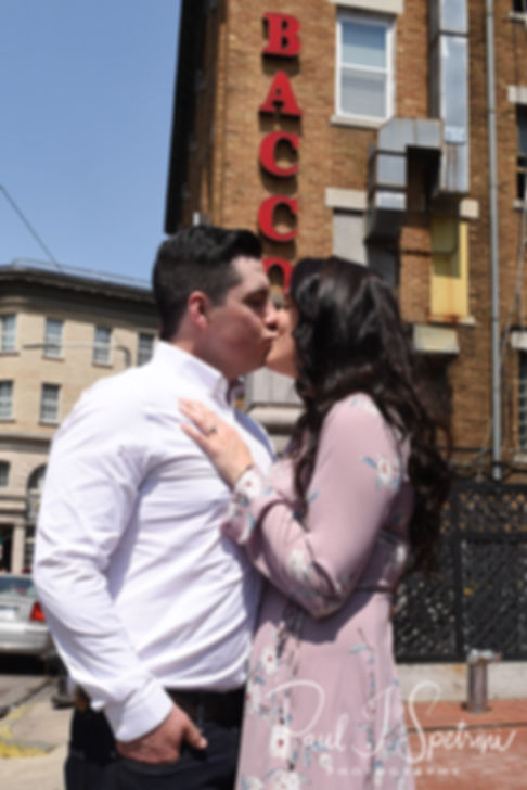 Nicole and Dan kiss for a photo in the North End neighborhood of Boston, Massachusetts during their May 2018 engagement session.