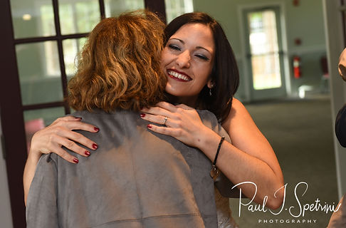 Amanda hugs a guest during her October 2018 wedding reception at Loon Pond Lodge in Lakeville, Massachusetts.