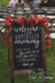 A sign greets guests during Justine & Jon's October 2018 wedding ceremony at Twelve Acres in Smithfield, Rhode Island.