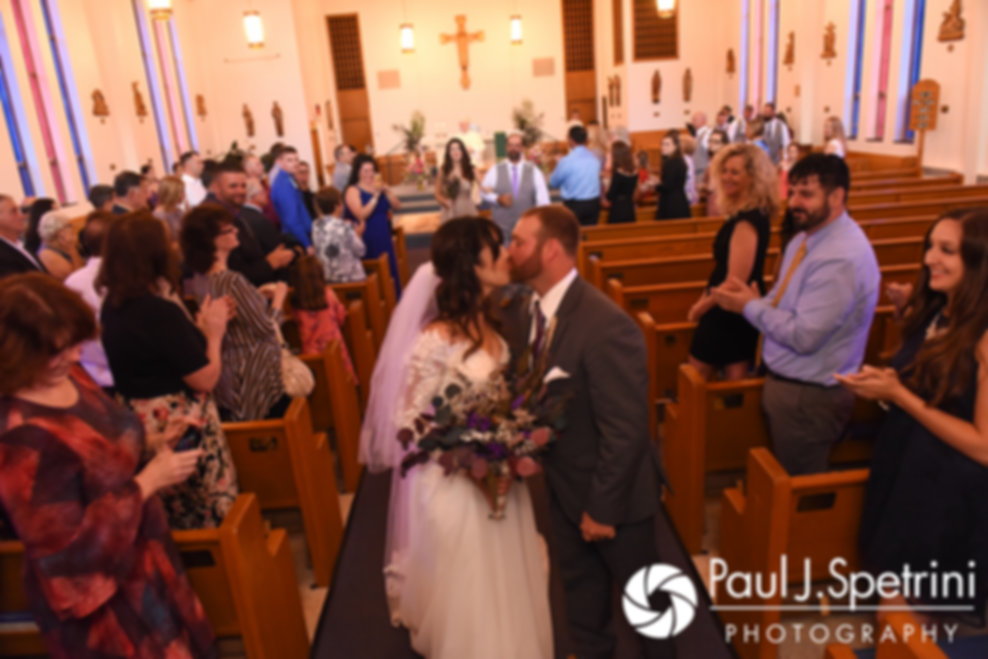 Samantha and Dale kiss at the end of the aisle following their October 2017 wedding ceremony at St. Robert's Church in Johnston, Rhode Island.