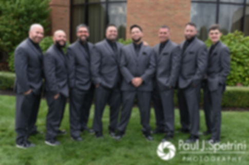 Dallas pose for a formal photo with his groomsmen following his September 2017 wedding ceremony at the Crowne Plaza Hotel in Warwick, Rhode Island.